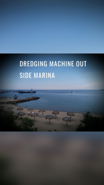 Dredging machine out side marina